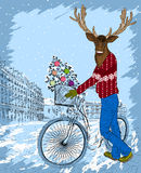 Deer on bike with christmas tree Royalty Free Stock Images