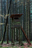 Hunting blind in dark forest. An elevated hunting blind with ladder and windows in a forest in Germany at fall Stock Photography