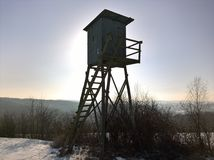 Deer Blind High. Hunter`s observation point in forest winter Royalty Free Stock Photography