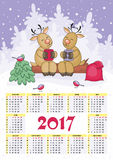 Deer calendar 2017. Calendar for 2017 with the image of funny animals and Christmas tree Royalty Free Stock Images