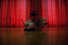 Red curtain low light art vase Royalty Free Stock Image