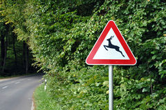 Deer crossing sign. A traffic sign that warns for possible deer crossing stock photography