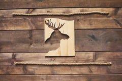 Deer cut in wooden board Royalty Free Stock Photo