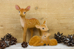 Deer family toys with pine cones Royalty Free Stock Image