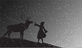 Deer. Girl with deer in the snowfall Stock Image