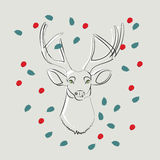 Deer with green eyes with leaves and berries Royalty Free Stock Photo