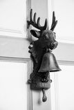 Deer head with bells and welcome letter that hung on the door. Royalty Free Stock Photos