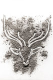 Deer head drawing in scattered ash Stock Photos