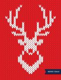 Deer head knitted pattern on red background. vector illustration