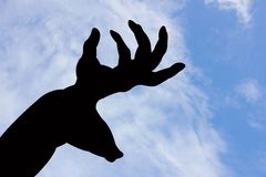 Deer and horn shape hand silhouette in blue sky and cloud, Stock Image