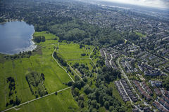 Deer lake and Burnaby, BC. Park with lake and homes in Burnaby, British Columbia, Canada stock photography