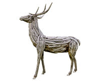 Deer made from wood. Wooden deer made from nature material, handmade royalty free stock photography