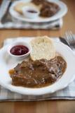 Deer meat in wine sauce Stock Photos
