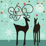 Deer partners. Stylized male and female deer with snowflake baubles winter christmas theme Stock Photos