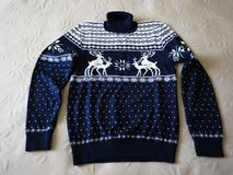 Deer, the pattern on the sweater. Men`s sweater with deer. Sweater for men, wool material.  Details. And close-up royalty free stock photography