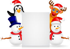 Deer,penguin and snowman with blank sign Stock Photography