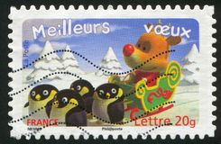 Deer with penguins. FRANCE - CIRCA 2007: stamp printed by France, shows deer with penguins, circa 2007 royalty free stock photography