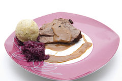 Deer roast with dumpling and red cabbage Stock Photos