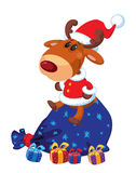 Deer Santa with bag and gifts Stock Photo