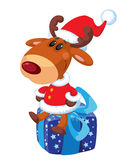 Deer Santa on the box Royalty Free Stock Images