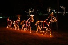 Deer & Santa Lighting. Santa & Deer light display at local park Stock Photo