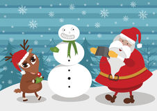 Deer and Santa making snowman Royalty Free Stock Photography