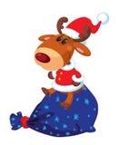 Deer Santa sits on the bag Royalty Free Stock Image