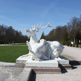 Deer Sculpture attacked by dogs Royalty Free Stock Photography