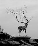 Deer sculpture on rock platform Royalty Free Stock Image
