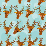 Deer Seamless pattern with funny cute animal face on a blue back Stock Photography