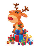 Deer sits on gifts box Royalty Free Stock Photography