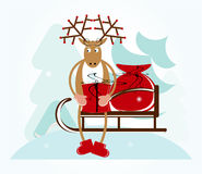 Deer with sleigh. And gift Royalty Free Stock Photos