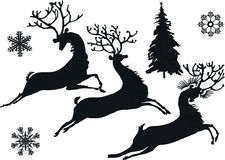 Deer and snowflake silhouettes Royalty Free Stock Image