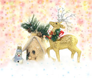 Deer, snowman and house on sparkle Xmas background Stock Images
