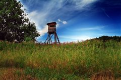 Deer-stand. Landscape with blue sky Royalty Free Stock Images