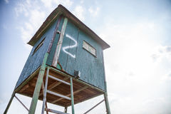 Deer stand with blue sky in the background Stock Photo