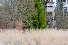A deer stand in front of a meadow in the Natural Reserve schoenb. Uch in Germany Stock Photo