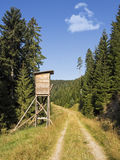Deer stand hunting tower in forest Royalty Free Stock Image