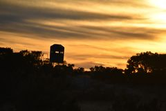 Deer Stand at Sunset stock photo