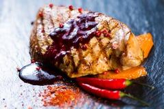 Deer steak with cranberries sauce Stock Photos
