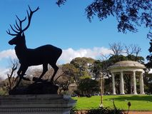 A deer and a temple royalty free stock photo