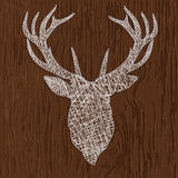 Deer thread. Vector illustration of a silhouette of deer thread. Drawing on a wooden background Royalty Free Stock Photo