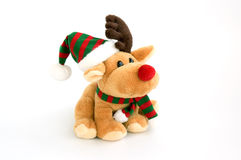 Deer toy. Deer - christmas toy weared cap and scarf isolated over white Royalty Free Stock Images