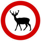 A deer in a traffic sign Stock Photo