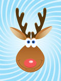 Deer twirl. Christmas deer's face over blue twirled background Royalty Free Stock Photography