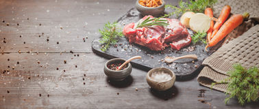 Deer or venison roast. Traditional finnish food, rosvopaisti, with Chanterelle fungus, Sea salt, red, green, white pepper and coriander in clay pots on an old Royalty Free Stock Photos
