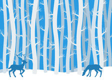 Deer in winter forest Stock Image