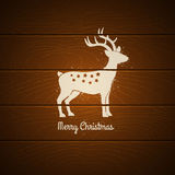 Deer on wooden background Royalty Free Stock Photography