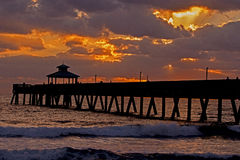 Deerfield Beach Sunrise. The Deerfield Beach, Florida, pier provides a lovely setting to enjoy a breathtaking sunrise over the surf. The town is at the northern stock photo