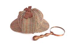 Deerhunter or Sherlock Holmes cap and vintage magnifying glass Stock Images